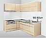 壁付けL型のキッチンスペースの写真